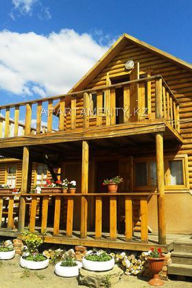 Three-room two-story log house