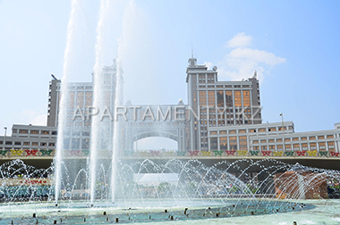 Architecture of Astana, fountain on round area near KazMunayGaz